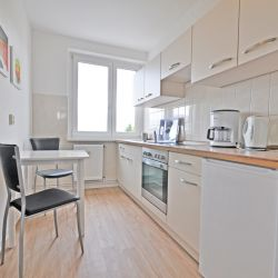 Fully equipped, bright kitchen with two seats