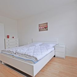 Simple, friendly bedroom with large double bed